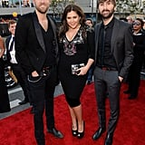 Lady Antebellum posed together on the carpet.