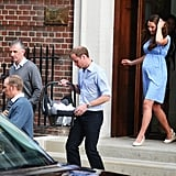 Prince William carried the royal baby to the car as he and Kate Middleton prepared to leave the hospital.