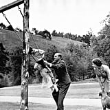 Prince Charles enjoys a simple rope and plank swing