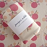 Mid-weight and constructed from a soft organic cotton, Juniper Wilde's Ranunculus & Berry Knit Swaddle ($42) is a pretty pick for baby girl.