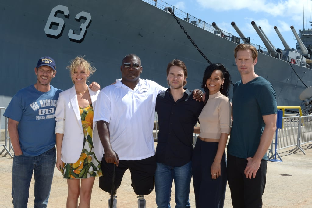 """Rihanna joined her Battleship costars Alexander Skarsgard, Taylor Kitsch, and Brooklyn Decker, as well as director Peter Berg, at Friday's photocall for the film. The stars returned to Hawaii, where they shot the movie last Summer, for the US press junket. They posed in front of Pearl Harbor's USS Missouri Memorial with naval vet Gregory D. Gadson — stay tuned for our exclusive interviews with the cast! Rihanna flashed her midriff for the photo op. She also shows skin in her new video, which is out today. """"Where Have You Been"""" is already a hit on the charts, and with Rihanna in a bikini, the video is sure to be just as popular. Rihanna, Brooklyn, Alexander, and Taylor head back to the mainland next week and are expected to attend an LA premiere on May 10 before the May 18 opening."""