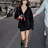 Bella Hadid Rocked a Black Zip-Up Sweater With Bike Shorts During MFW