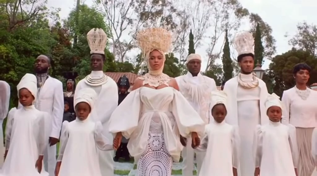 Beyoncé wears custom Alon Livné, who created three separate looks from scratch for the film. The look is completed with a Laurel DeWitt headpiece.