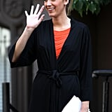 Blake Lively waved while preparing to film a scene in NYC.