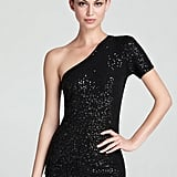 DKNY's black sequined one-shoulder top ($85) screams sophisticated holidaywear. Sport it with bright red bottoms for an even bolder look.