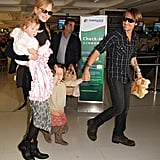 Nicole Kidman and Keith Urban boarded a flight in Australia with daughters Faith and Sunday.