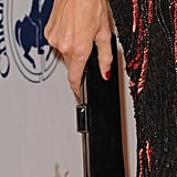 Her red nails and black Judith Leiber clutch played off the dress's color palette perfectly.