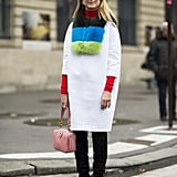 Natalie Joos added oomph to a stark white coat with pops of color on her fur, turtleneck, and pastel pink bag. Source: Le 21ème | Adam Katz Sinding