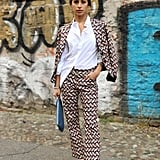 Fully tuck a button-down into your pantsuit at work for a polished look. As soon as that clock strikes 5pm, however, do the half-tuck for a more casual feel.