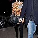 Nicole Richie was wrapped up in a fur jacket before takeoff.