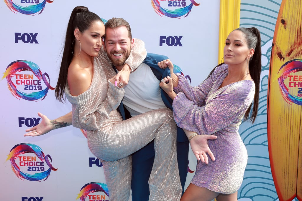 Nikki Bella, Artem Chigvintsev, and Brie Bella at the 2019 Teen Choice Awards