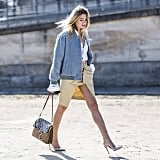 In Real Life: Blogger Camille Charrière was spotted rocking this not-so-simple style during a sunny day in Paris. Not only is the shorter length perfect for the warmer weather, it will help to elongate your legs, especially when paired with heels.