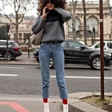 Slip into white boots to up the ante on skinny jeans and a sweater.