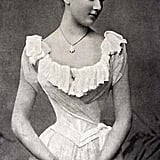 A woman wears a corseted look in 1896.