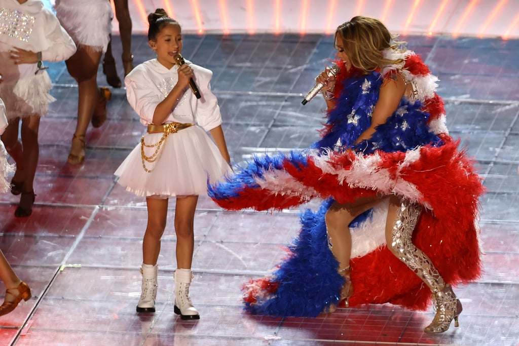 "As expected, the 2020 Super Bowl halftime show was not without several surprises. Following appearances by Bad Bunny and J Balvin, who joined headliners Jennifer Lopez and Shakira onstage, a particularly heartwarming cameo was made by Jennifer's own daughter, Emme Maribel Muñiz.  In her casual halftime show debut, the talented 11-year-old took part in a mashup of ""Let's Get Loud"" and ""Waka Waka (This Time For Africa)"" alongside other young singers. This isn't the first time Emme has performed with Jennifer. In fact, the mother-daughter duo previously sang ""Limitless"" together during one stop on the It's My Party tour. See pictures from their latest, high-profile duet ahead."