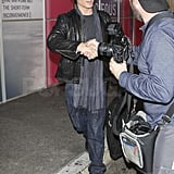 Ian shook hands with a photographer.