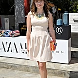 Sophia Bush stopped by the Harper's Bazaar Coachella party in a neutral H&M dress — but the real statement-makers were her colorful bib necklace, gold metallic Monika Chiang oxfords, and orange box clutch by CC Skye.
