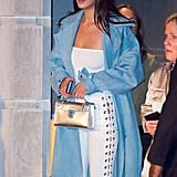 White lace-up jeans might not be your pick of choice, but when paired with a light blue denim trench you have to admit the outfit is worth a try. Bella's got the right idea on mixing two different colored denims together.