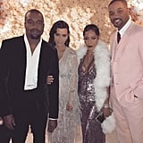 Kanye West, who wore a velvet suit, posed with Kim, Jada Pinkett Smith, and Will Smith, who chose a dusty pink ensemble.