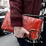 Subversive metal hardware added an edgy touch to this red leather clutch.