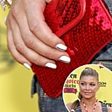 At the 2005 Teen Choice Awards, Fergie decorated a plain white manicure with a simple black line drawn down the middle.