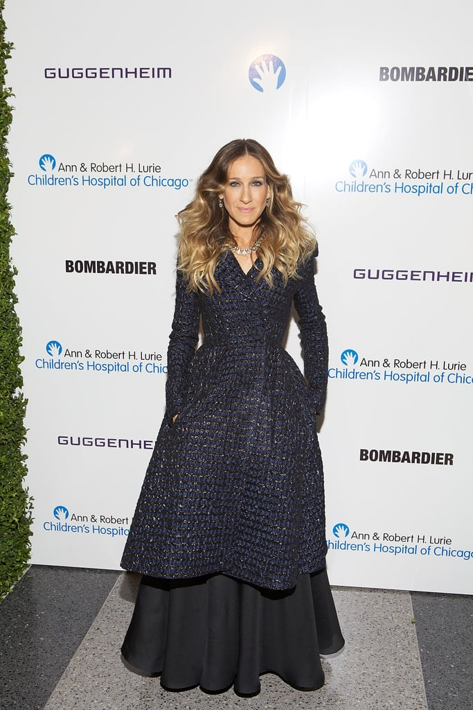 Parker topped her voluminous black gown with a navy tweed coat by Oscar de la Renta for a 2012 Chicago gala.