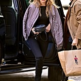 Gigi wearing her black suede Lowland  boots.