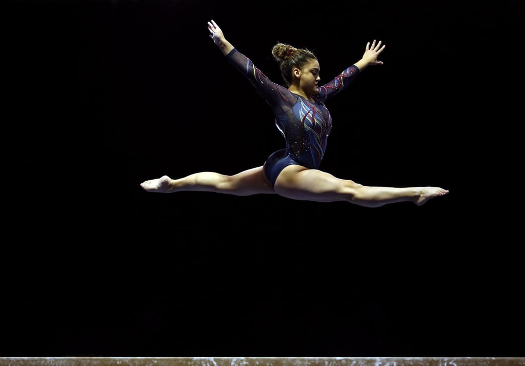 """Laurie Hernandez is drawing on the power of superheroes as she makes a momentous return to competitive gymnastics. On Feb. 27, the 20-year-old athlete participated in her first meet after a nearly five-year hiatus. Such a highly anticipated occasion called for an equally incredible outfit, and Hernandez went above and beyond with her Captain Marvel-inspired leotard.  The GK Elite activewear features the signature red, yellow, and blue colours of Captain Marvel's famous suit, replicating the hero's electric energy. According to Hernandez's Instagram, this is just the start of her themed looks this year. """"I told some of y'all that my leos i designed for this year are all inspired by superheroes... here's the first one!"""" she wrote, tagging Captain Marvel actress Brie Larson. Hernandez continues to keep fans on their toes as she teased a possible Scarlett Witch leotard in line with the WandaVision hype. We'll just have to wait and see what she brings out next!"""