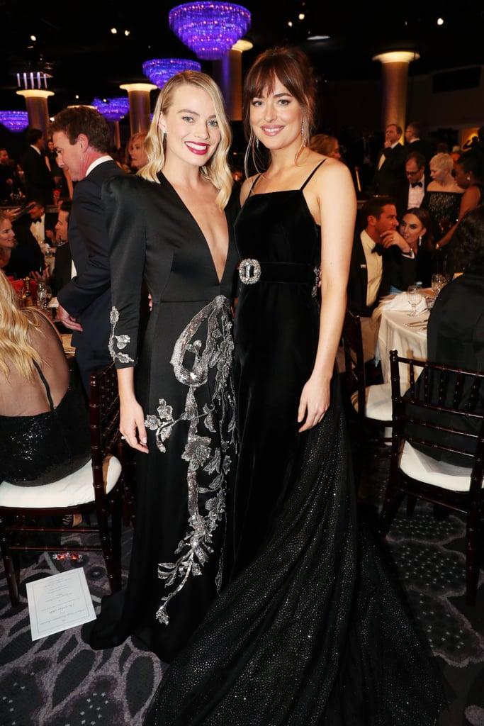 Pictured: Margot Robbie and Dakota Johnson