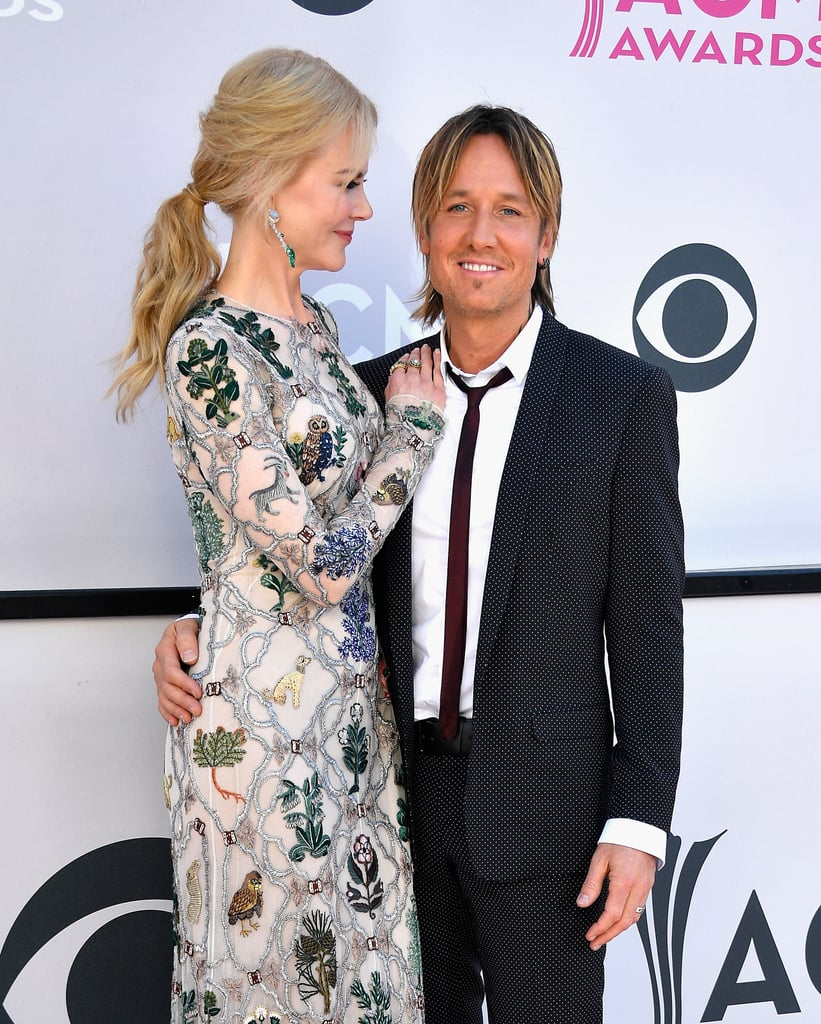 Nicole Kidman and Keith Urban brought their love to the ACM Awards in Las Vegas on Sunday. The couple — who will be celebrating 11 years of marriage in June — were as cute as can be while playing up their sweet chemistry on the red carpet. Keith is up for a handful of awards tonight, including entertainer of the year against Carrie Underwood, so it's a good thing he has his good luck charm by his side.