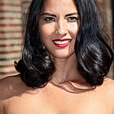 Olivia Munn kept things classic with curled ends and a bright red lipstick for her appearance on Late Show.