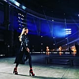 Gigi practiced for the Versace show in her leather jacket and platform pumps. She shared this rehearsal shot on Instagram.