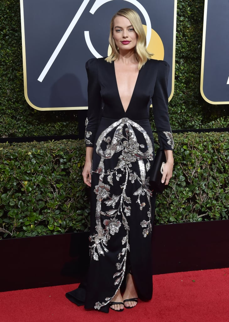 Margot stunned in this embellished Gucci design with a plunging neckline at the 2018 Golden Globes.
