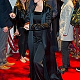 She Then Switched Into a Black Jumpsuit and Long Silk Duster