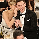 Jennifer Lawrence whispered something to her boyfriend, Nicholas Hoult.  Source: Christopher Polk/NBC/NBCU Photo Bank/NBC