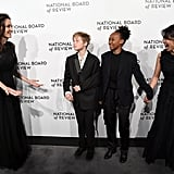 Angelina Jolie, Shiloh and Zahara Jolie-Pitt, and Loung Ung attending the National Board of Review Awards Gala