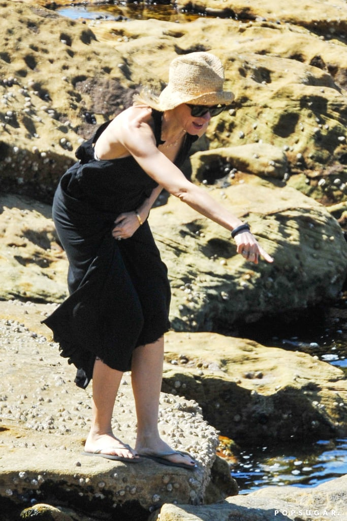 Naomi Watts wore a casual black dress on the family's adventure.