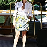 Italian starlet Violante Placido showed off her summery brights by way of a floral-printed skirt and blue T-strap sandals.