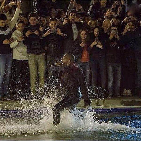 """Kanye West put on a free concert in Armenia on Sunday, but the show was shut down after the rapper jumped into the lake and a mob of fans did the same. His wife, Kim Kardashian, took to Twitter to announce that Kanye would do a free concert at midnight, and later, she followed up with tweets and pictures about the """"crazy night."""" So what, exactly, prompted the show to be shut down? While performing """"Good Life,"""" Kanye spontaneously decided to jump into Swan Lake, and fans took the opportunity to join him. Soon, security guards had to wade into the lake to help him out, and police were forced to shut down the concert entirely. On Twitter, Kim explained, """"Thousands of people were there! Kanye jumped in Swan Lake to be closer to the crowd on the other side & so many people jumped in too!"""" Keep reading to check out a video of the moment plus Kim's tweets and pictures, then see why the Kardashians' trip to Armenia matters.  Kanye is doing a free concert for everyone in Yerevan at midnight tonight Swan Lake- Karapi Litch! See you there!— Kim Kardashian West (@KimKardashian) April 12, 2015     Thousands of people were there! Kanye jumped in swan lake to be closer to the crowd on the other side & so many people jumped in too!— Kim Kardashian West (@KimKardashian) April 12, 2015     Such an exciting crazy night! So happy I got to rock out with everyone in Armenia on our last night here!!!! #EpicNight #ArmenianPride— Kim Kardashian West (@KimKardashian) April 12, 2015    Source: Twitter user KimKardashian"""