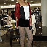 Richie dresses up black and white with bohemian details: geometric print tights and a fabulous red kimono.