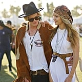 Cody Simpson's Western-inspired outfit looked just right with Gigi Hadid's boho-cool look: a white breezy dress, a neutral belt, turquoise beads, and a complementing head scarf.