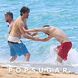 Charlie Hunnam and Garrett Hedlund Wrestle in Hawaii Photos