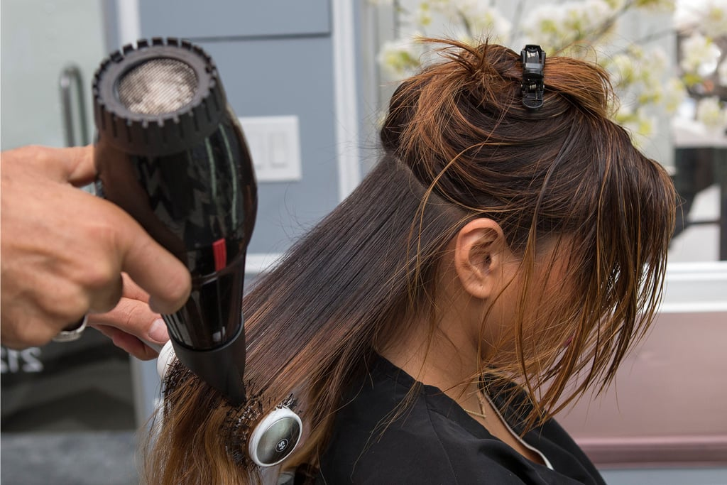"Use a round brush to straighten your strands. ""The tension of the round brush will smooth out even curly hair types,"" Pipino says."
