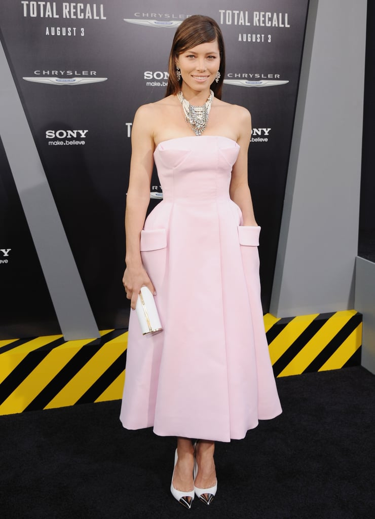 Jessica Biel took a risk with this dramatically nipped-at-the-waist pink Christian Dior Couture dress at the LA premiere of Total Recall. To finish, she wore a statement Tom Binns necklace, silver cap-toe Louis Vuitton pumps, and a Jimmy Choo clutch.