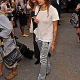 Zoe Kravitz in metallic pants and a white tee at Alexander Wang.