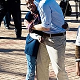 Harry hugged a young girl at the Mamohato Network Club at King Letsie's Palace in 2010.