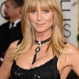 Heidi Klum took a cue from Farrah Fawcett, working a blunt fringe, flipped strands, and beach-babe makeup.