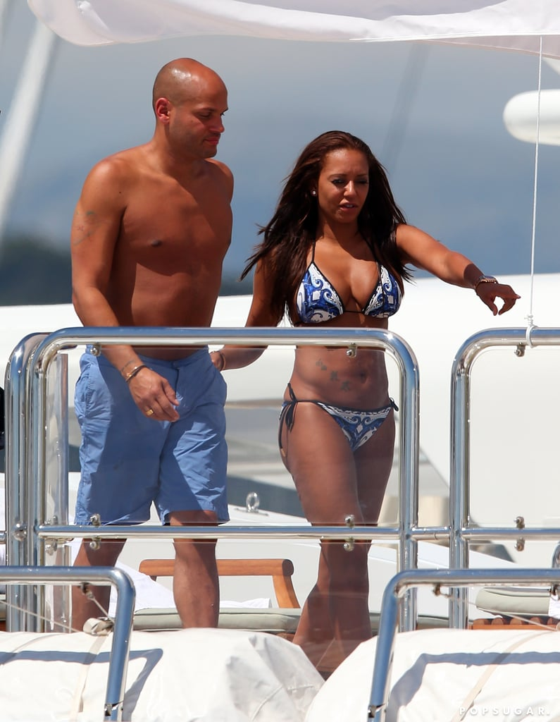 "Mel B stripped down to a blue and white bikini when she had a yacht party with a group of friends and her husband, Stephen Belafonte, in Cannes on Wednesday. The couple were in the South of France to attend a charity dinner on Tuesday with model Natalia Vodianova. Mel spoke at the event, which raised money for the Naked Heart Foundation and FilmAid. She will soon be back on a plane yet again to return to the UK where she hinted she may meet up with her former Spice Girls pals. Mel wrote about her trip in a blog entry last week while shooting down news of a reunion. She wrote, ""Press as usual writing BS about Spice Girls. As usual, us girls know what's gonna happen, so they just need to shut up. Heading to Cannes Cinemoi and UK to see my Spices, yippee."" Maybe Mel will have a chance to meet up with Victoria Beckham, who is settling down after news broke that her husband, David Beckham, is retiring from soccer. Victoria and her family travelled to Paris last weekend to watch David play his final home game with PSG. The team has one more game to play this weekend, but it isn't clear if David will take the field for that match."