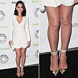 Olivia Munn's little white dress got a jolt of shine thanks to her gold pumps with white ankle straps at PaleyFest in LA.