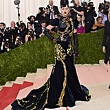 The theme for the 2016 Met Gala was Manus x Machina: Fashion in an Age of Technology. Katy wore a midnight blue velvet Prada gown with gold trim and long gloves.